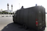 A riot police vehicle is parked in front of Al-Azhar University during clashes with protesters in Cairo October 20, 2013. REUTERS/Mohamed Abd El Ghany