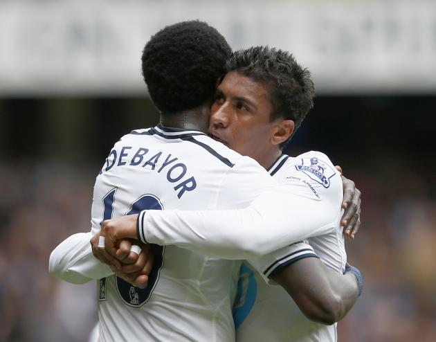 Tottenham Hotspur's Paulinho celebrates with teammate Adebayor after scoring goal against Fulham during their English Premier League soccer match at White Hart Lane in London