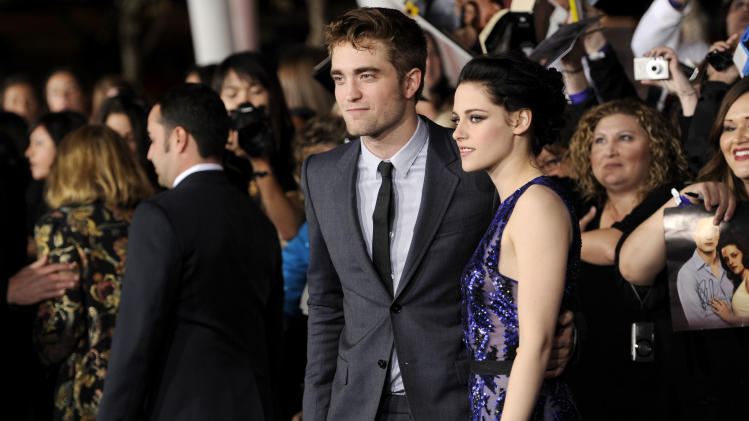 "Robert Pattinson, left, and Kristen Stewart arrive at the world premiere of ""The Twilight Saga: Breaking Dawn - Part 1"" on Monday, Nov. 14, 2011, in Los Angeles. (AP Photo/Chris Pizzello)"
