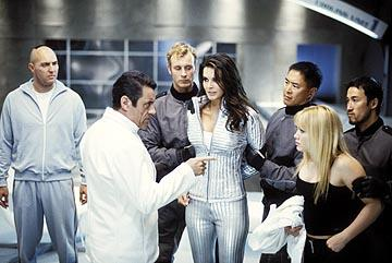 Molay ( Arnold Vosloo , far left) and Brinkman ( Ian McShane ) inform Ronica ( Angie Harmon ) and Natalie ( Hilary Duff ) of their evil plan in MGM's Agent Cody Banks
