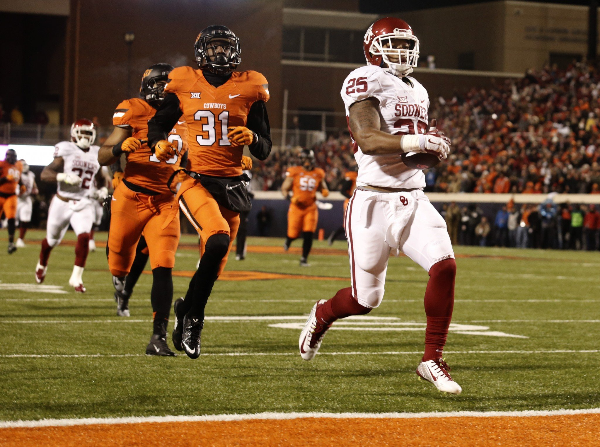 If the Big 12 had a true title game in 2016, the Oklahoma schools would play twice in two weeks. (Getty)