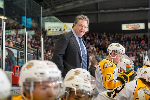 KELOWNA, CANADA - OCTOBER 25: Head coach Kelly McCrimmon of Brandon Wheat Kings stands on the bench during first period against the Kelowna Rockets on October 25, 2014 at Prospera Place in Kelowna, British Columbia, Canada. (Photo by Marissa Baecker/Getty Images)