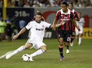 Real Madrid's Gonzalo Higuain (left) outsmart Urby Emanuelson AC Milan during their match at Yankee Stadium in New York last week