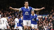 Leighton Baines celebrates scoring a penalty for Everton against Swansea (Reuters)
