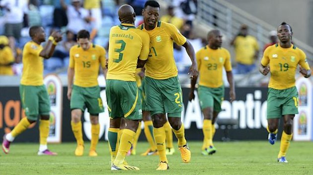 South Africa's Defender Siyabonga Sangweni (R) celebrates with a team mate after scoring a goal during the South Africa vs Angola Africa Cup of Nations 2013 group A football match at Moses Mahiba Stadium in Durban on January 23, 2013 (AFP)