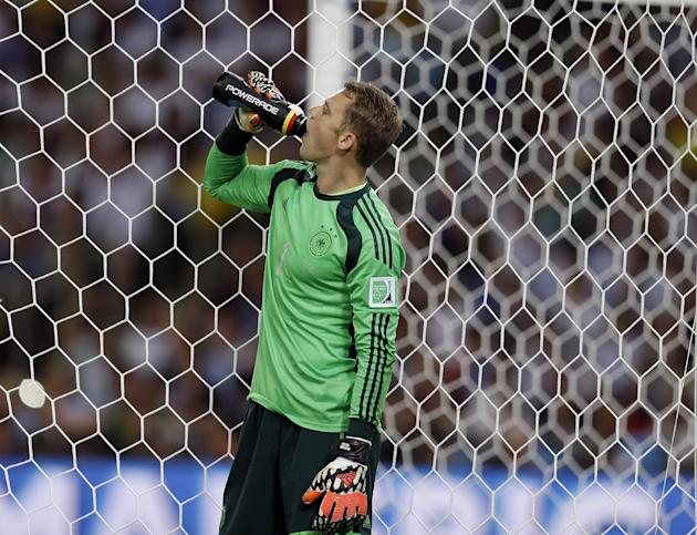 DISTRIBUTED FOR TCCC - Germany goalkeeper Manuel Neuer takes a Powerade break while taking on Argentina during the World Cup final soccer match at the Maracana Stadium in Rio de Janeiro, Brazil, Sunda