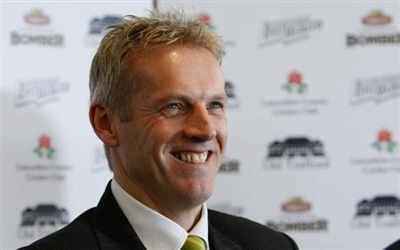 Former England cricket coach Peter Moores smiles at a news conference at Old Trafford in Manchester, northern England