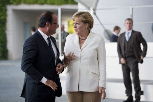 A photo made available by the German government press office shows Chancellor Angela Merkel greeting French President Francois Hollande as he arrives at the chancellery in Berlin on August 23. The leaders of France and Germany will tackle differences over EU banking supervision and a proposed tie-up between EADS and BAE at a meeting on Saturday, a German government spokesman said.