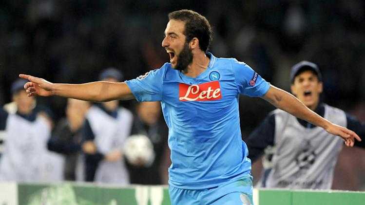 Napoli's Gonzalo Higuain celebrates after scoring during a Champions League, group F, soccer match between Napoli and Marseille, at the Naples San Paolo stadium, Italy, Wednesday, Nov. 6, 2013