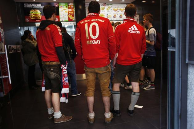Bayern Munich supporters wait to order food in central Madrid
