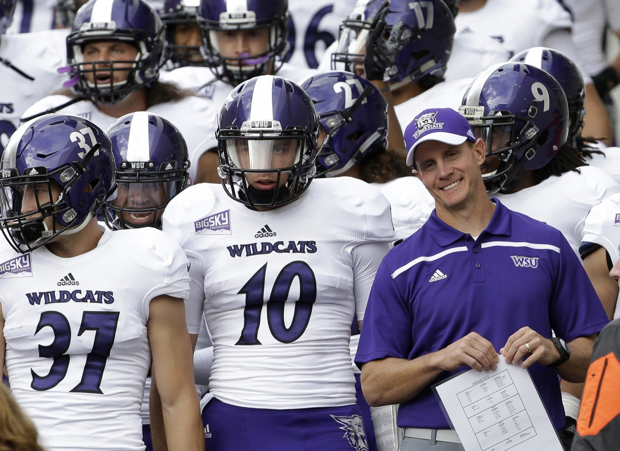 Weber State had football coach Jay Hill is shown with his team before an NCAA college football game against Oregon State in Corvallis, Ore., Friday, Sept. 4, 2015. (AP Photo/Don Ryan)