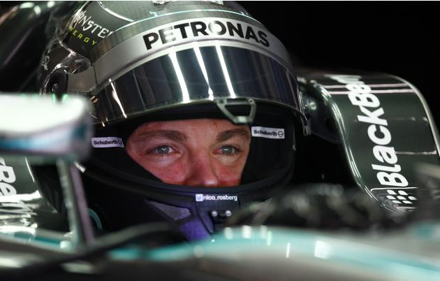 Mercedes Formula One driver Rosberg of Germany sits in his car during the second practice session of the Chinese F1 Grand Prix at the Shanghai International circuit