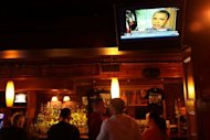 Patrons at the Stonewall Inn, a historic gay bar in Greenwich Village, watch a news report as Barack Obama became the first US president to say publicly he was in favor of same-sex marriage, in a high-stakes intervention in a pre-election debate roiling American politics.
