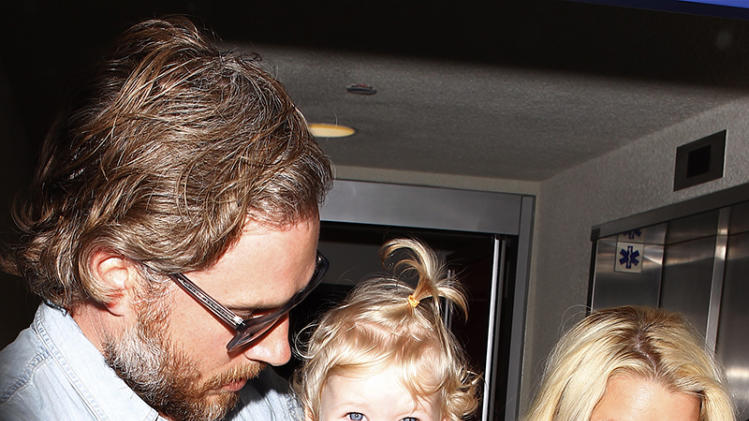 Pregnant Jessica Simpson and family arriving on a flight at LAX