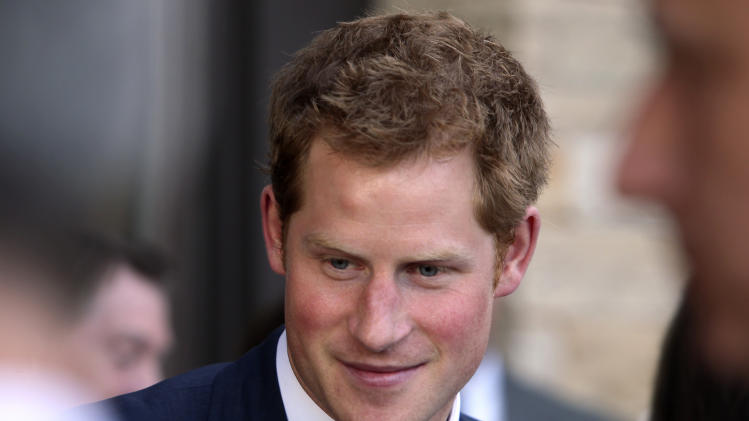 Britain's Prince Harry talks with a guest at a reception at the Sanctuary Golf Course in Sedalia, Colo., south of Denver on Friday, May 10, 2013. (AP Photo/Ed Andrieski, Pool)
