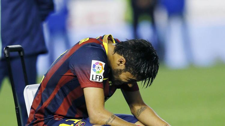 Barcelona's Neymar reacts after losing to Real Madrid at the end their King's Cup final soccer match at Mestalla stadium in Valencia