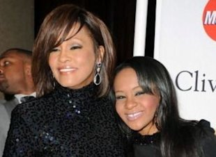 Whitney Houston, dead at the age of 48, with daughter Bobbi Kristina Brown.