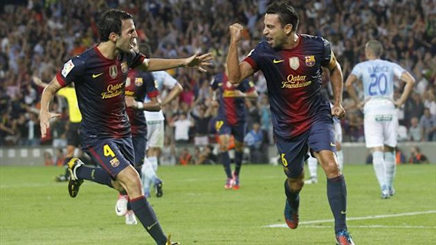 Xavi celebrates his strike against Granada (Reuters)