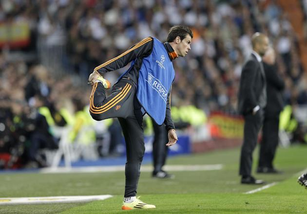 Real's Gareth Bale warms up during a  Champions League semifinal first leg soccer match between Real Madrid and Bayern Munich at the Santiago Bernabeu stadium in Madrid, Spain, Wednesday, April 23