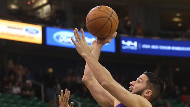 Cousins leads Kings past Jazz 112-102 in OT