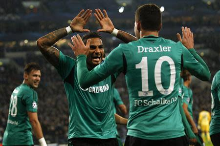 Schalke 04's Boateng and Draxler celebrata goal against Steaua Bucharest during their Champions League group E soccer match in Gelsenkirchen