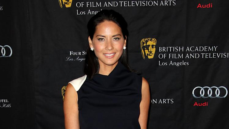 Actress Olivia Munn arrives at the BAFTA Awards Season Tea Party at The Four Seasons Hotel on Saturday, Jan. 12, 2013, in Los Angeles. (Photo by Matt Sayles/Invision/AP)