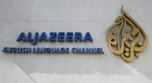 The logo of Qatar-based Al Jazeera satellite news channel is seen in Doha