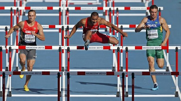 Ashton Eaton of the U.S. (C) clears a hurdle next to Michael Schrader of Germany (L) and Carlos Chinin of Brazil (R) in their men's decathlon 110 metres hurdles event during the IAAF World Athletics Championships at the Luzhniki stadium in Moscow (Reuter)
