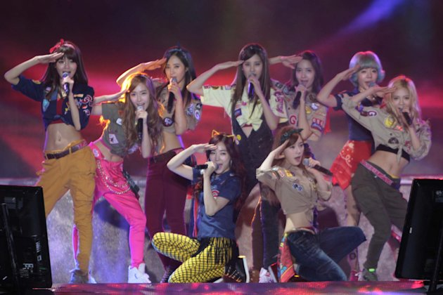 "Kpop group ""Girls Generation"" performs for the crowd during the ""Dream Kpop Fantasy Concert"" held at the Mall of Asia grounds in Pasay city, south of Manila on 19 January 2013."