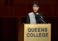 "Aung San Suu Kyi speaks to students at Queens College in New York. Her desire, she said, is that ""Burma can once again become the country it was way back before the military regime took over, a country of hope."""