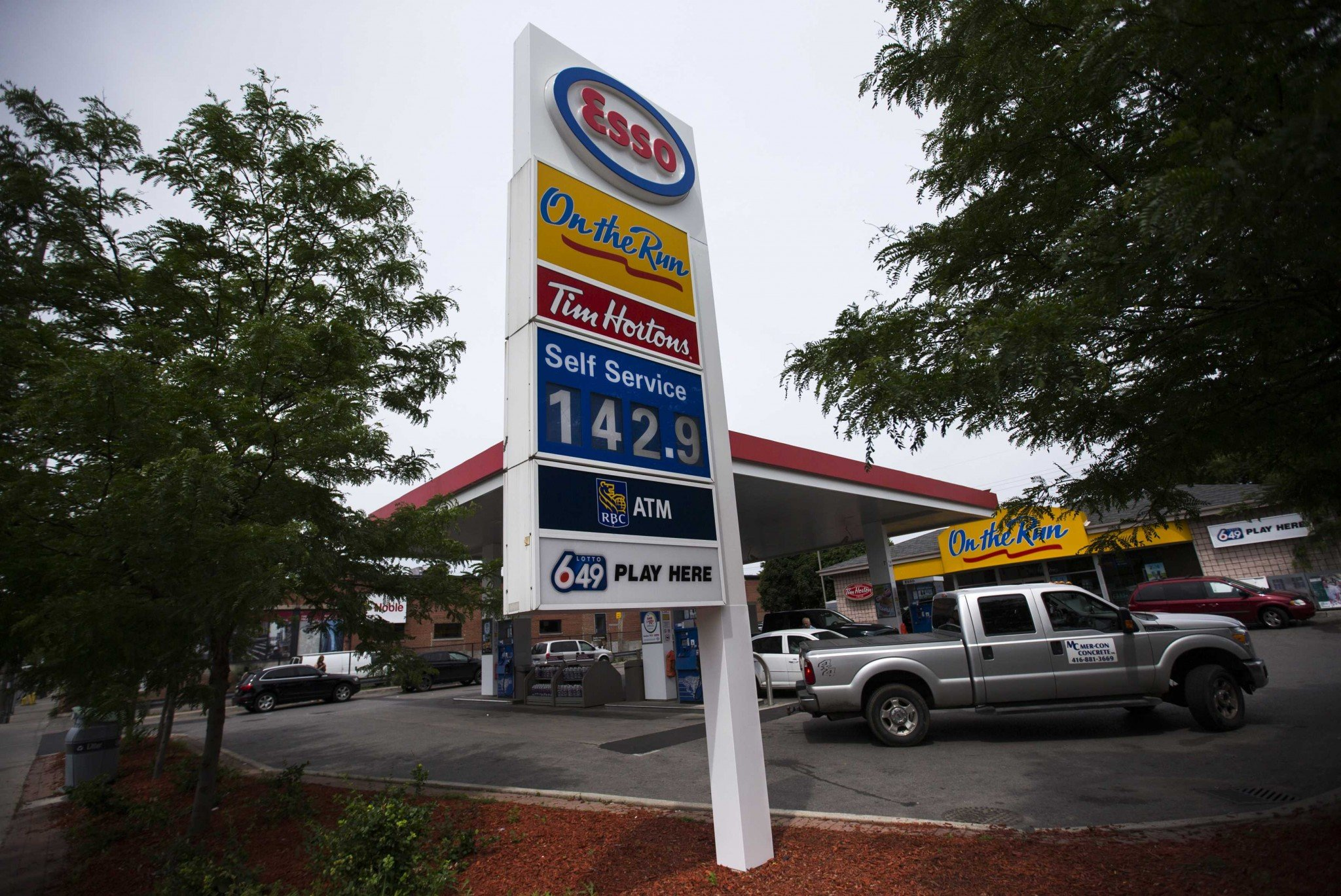 An Esso gas station displays gas prices in Toronto, June 23, 2014. (Reuters)
