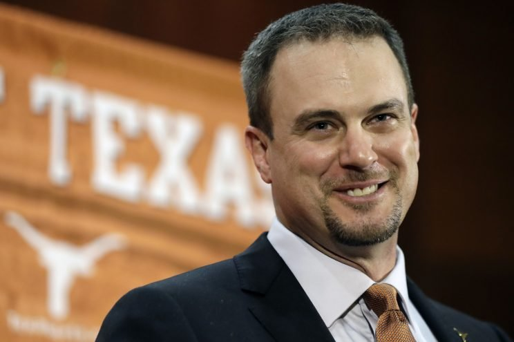 Texas introduces new coach Tom Herman at a Saturday press conference. (AP)