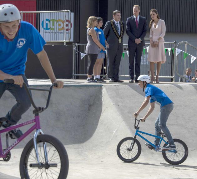 Britain's Catherine, Duchess of Cambridge and her husband Prince William stand with the City of Playford Mayor Glenn Docherty at a skate park in Elizabeth near Adelaide