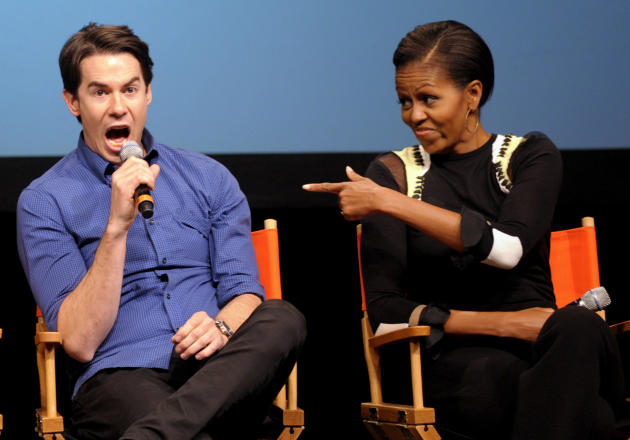 "First lady Michelle Obama points toward Nickelodeon's iCarly cast member Jerry Trainor as they answer student's questions during a special screening of ""iMeet The First Lady"" episode of the show, Frid"