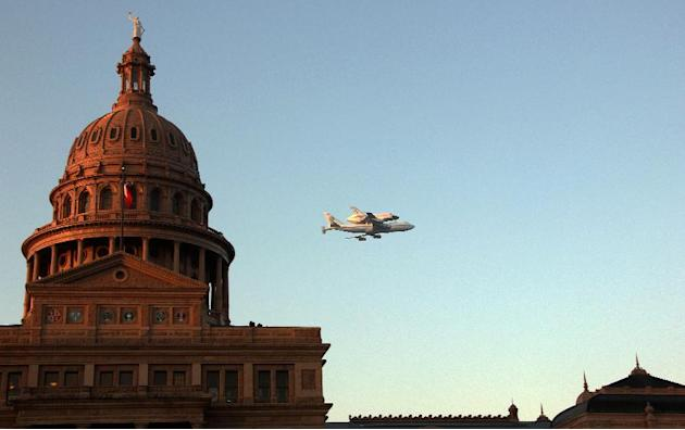 Space Shuttle Endeavour sits atop the shuttle aircraft carrier,  flies over downtown Austin, Texas early Thursday, Sept. 20, 2012.   Endeavour is making a final trek across the country to the Californ