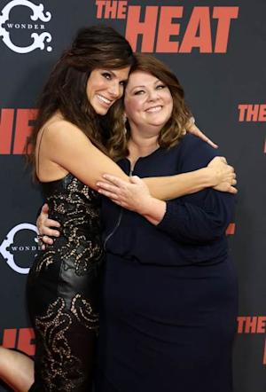 Cute! Sandra Bullock and Melissa McCarthy share a hug at 'The Heat' New York Premiere at Ziegfeld Theatre in New York City on June 23, 2013 -- Getty Images