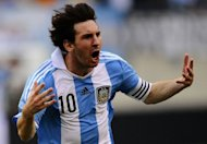 Argentinian soccer player Lionel Messi celebrates after scoring his third goal during a friendly match against Brazil in East Rutherford, New Jersey. Argentina won 4-3