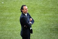 Italian head coach Cesare Prandelli walks on the pitch before the Euro 2012 football championships final match Spain vs Italy at the Olympic Stadium in Kiev. Prandelli confirmed on Sunday that he intends to stay on as Italy coach, after his side were soundly beaten 4-0 by Spain in the Euro 2012 final in Kiev
