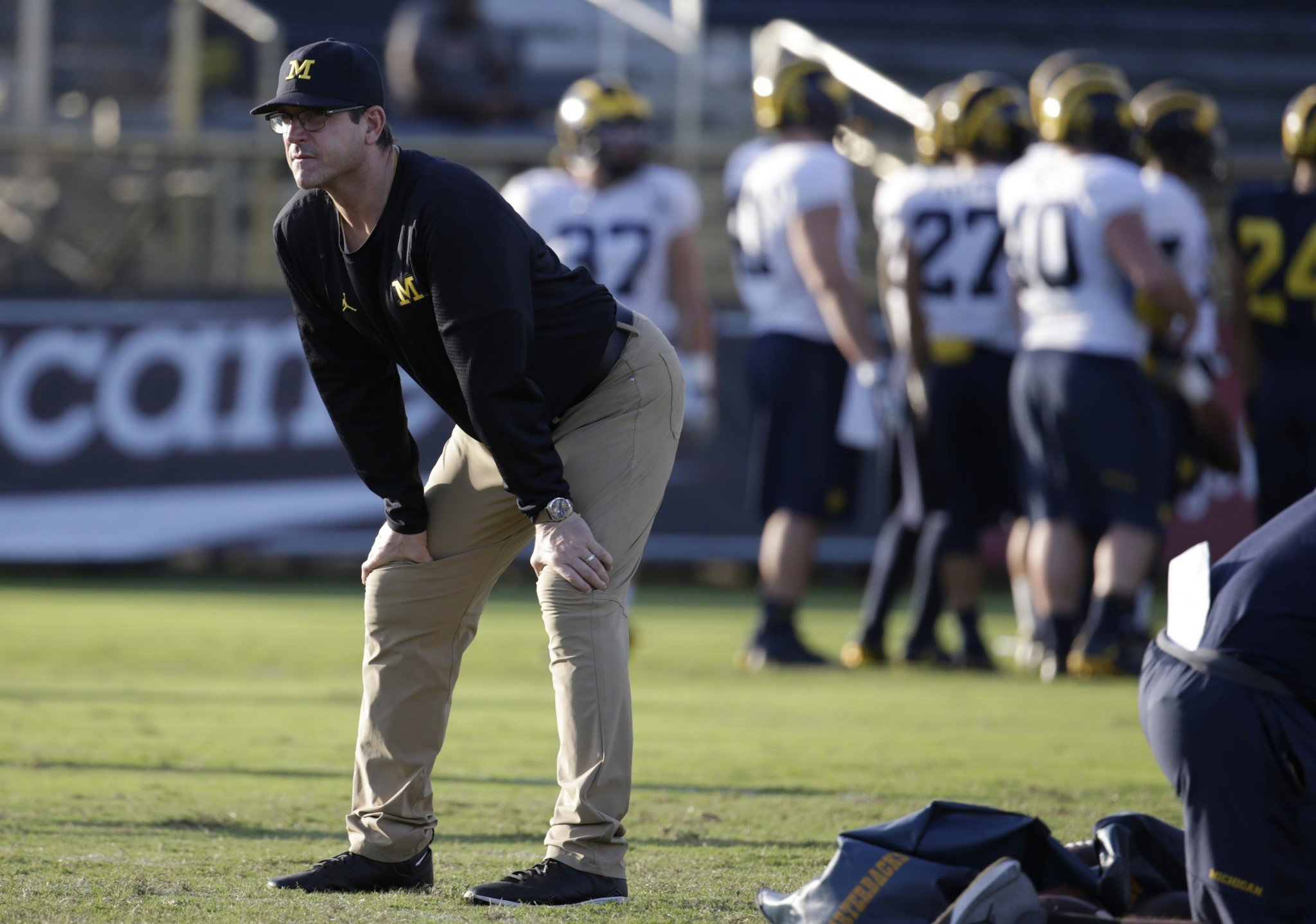 Jim Harbaugh and his khakis are going international. (AP Photo/Lynne Sladky)