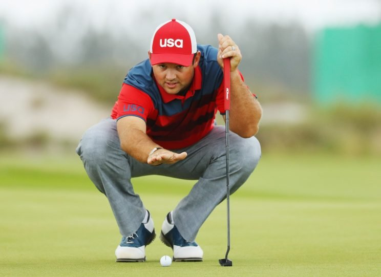 Patrick Reed sizes up a putt at the Olympic golf tournament. (Getty Images)