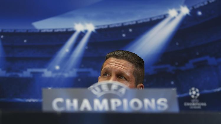 Atletico's coach Diego Simeone, of Argentina gestures during a press conference ahead of Tuesday's Champions League, semifinal, first leg, soccer match against Chelsea, at the Vicente Calderon stadium, in Madrid, Spain, Monday, April 21, 2014