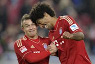 Bayern Munich defender Dante (R) and midfielder Xherdan Shaqiri celebrate beating Stuttgart 2-0 in the Bundesliga on January 27, 2013. After an unimpressive first-half display, Bayern roared back with Croatia striker Mario Mandzukic capitalising on a mistake in the Stuttgart defence for the first goal before setting up Thomas Mueller for the second