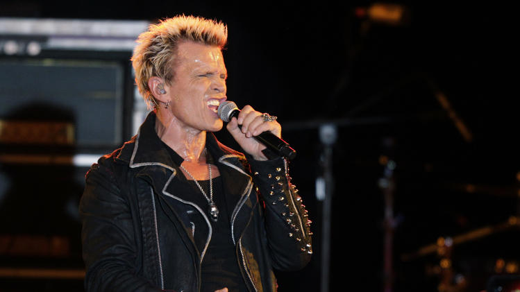 Billy Idol performs Friday, Oct. 26, 2012, in Seattle. Idol came to play in Seattle after Michael Henrichsen launched a two-year grass-roots campaign to convince the rock start to play for his birthday party. (AP Photo/Ted S. Warren)