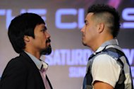 Philippine boxing icon Manny Pacquiao (L) and Brendon Rios of the US go face-to-face during a pre-fight press conference in Macau on July 27, 2013. Pacquiao insists he is as fit as ever and has ignored calls from friends, family and media commentators, fearful for his health, to call it a day