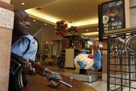 A police officer tries to secure an area inside the Westgate Shopping Centre where gunmen went on a shooting spree in Nairobi September 21, 2013. REUTERS/Siegfried Modola