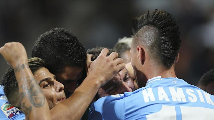 Napoli forward Gonzalo Higuain, second from right, of Argentina, celebrates with his teammates Marek hamsik, of Slovakia, right, and Lorenzo Insigne, left, after scoring during the Serie A soccer match between AC Milan and Napoli at the San Siro stadium in Milan, Italy, Sunday, Sept. 22, 2013