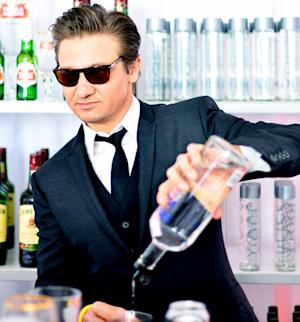 Jeremy Renner Pours Drinks for Friends at Independent Spirit Awards
