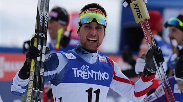 France's Jason Lamy Chappuis celebrates after winning the end of the men's cross country 10 km race of the Nordic Combined Individual Gundersen as part of the Val di Fiemme FIS Nordic World ski championships in Cavalese (AFP)