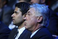 Paris Saint-Germain's head coach Carlo Ancelotti (R) and Chairman Nasser Al-Khelaifi of Qatar attend the draw for the UEFA Champions League group stage in Monaco