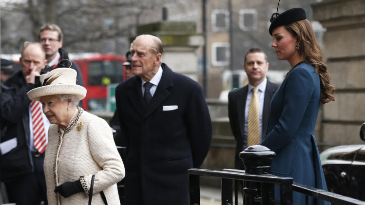 Britain's Kate, Duchess of Cambridge, right, accompanies Queen Elizabeth II, left, and Prince Philip, center, as they arrive at Baker Street underground station in London for a visit to mark the 150th anniversary of the London Underground, Wednesday, March 20, 2013. (AP Photo/Sang Tan)